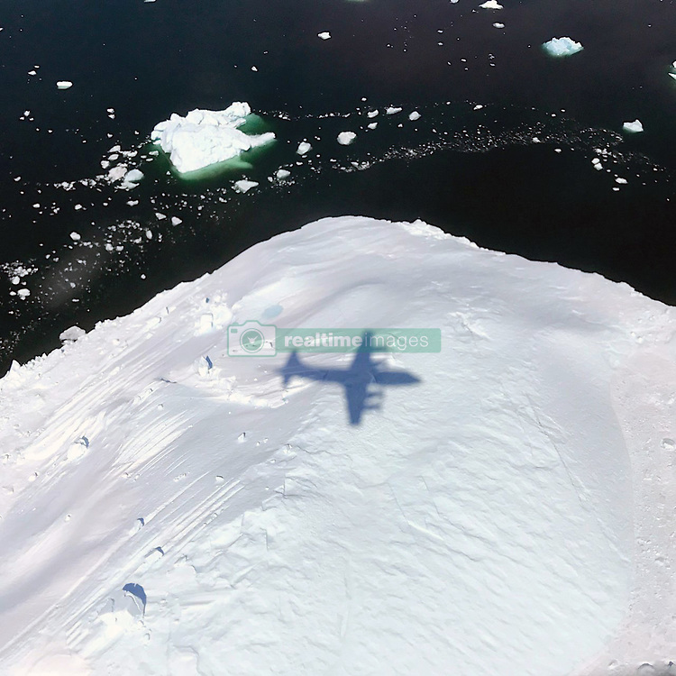 May 9, 2017 - Greenland - The shadow of NASA's P-3 aircraft is seen over an iceberg on a flight supporting NASA's Operation IceBridge mission. IceBridge began its final week of Arctic Spring 2017 surveys with a glacier-packed mission in Greenland, called Southeast Glaciers 01. The P-3 is a four-engine turboprop based out of Wallops and capable of long duration flights of 8-12 hours. It is supporting the same suite of IceBridge instruments flown in the past IceBridge Arctic and Antarctic campaigns. The original ICESat mission ended in 2009, and its successor, ICESat-2, is scheduled for launch in 2018. (Credit Image: ? Joe MacGregor/NASA via ZUMA Wire/ZUMAPRESS.com)