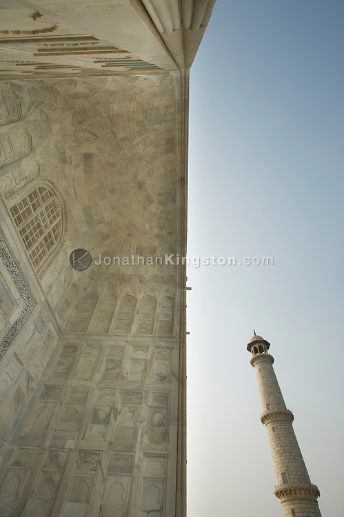 Low angle view of a pishtaq and minaret at the Taj Mahal, Agra, India.