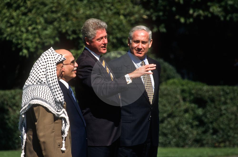 President Bill Clinton with PLO leader Yasser Arafat, King Hussein of Jordan and Israeli Prime Minister Benjamin Netanyahu at a White House October. 1, 1996 In Washington, DC.