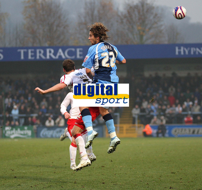 Photo: Karyn Haddon/Sportsbeat Images.<br />Wycombe Wanderers v Lincoln City. Coca Cola League 2. 17/11/2007.<br />Paul Green for Lincoln City and Sergio Torres for Wycombe Wanderers go for the ball.
