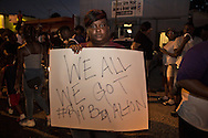 People protest after a vigil for Alton Sterling at the Triple S Food Mart in Baton Rouge, Wednesday, July 6, 2016.