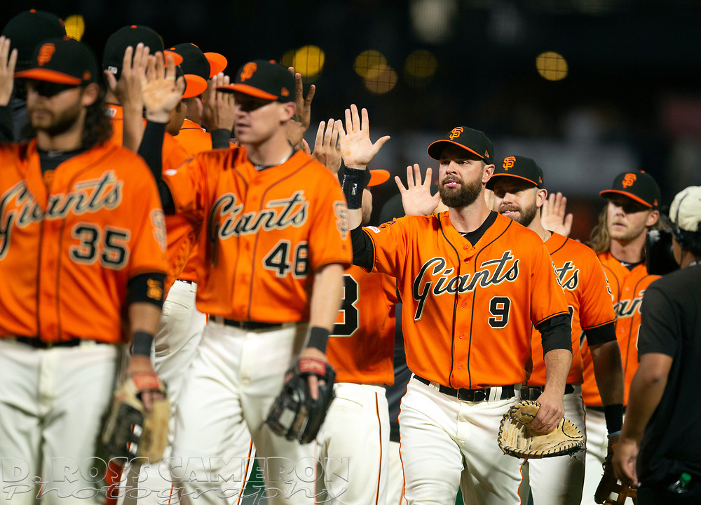 Sep 13, 2019; San Francisco, CA, USA; San Francisco Giants players celebrate their 1-0 victory over the Miami Marlins in a baseball game at Oracle Park. Mandatory Credit: D. Ross Cameron-USA TODAY Sports