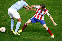 Atletico de Madrid´s Diego Godin (R) and Malmo´s Kiese Thelin during Champions League soccer match between Atletico de Madrid and Malmo at Vicente Calderon stadium in Madrid, Spain. October 22, 2014. (ALTERPHOTOS/Victor Blanco)