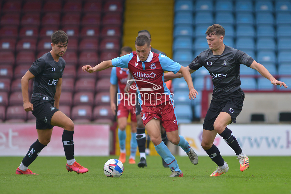 Bournemouth Loanee Frank Vincent (23) of Scunthorpe United battles for possession with Joe Wright of Doncaster Rovers u23 during the Pre-Season Friendly match between Scunthorpe United and Doncaster Rovers at Glanford Park, Scunthorpe, England on 15 August 2020.
