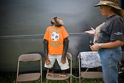 Ricki the chimp listens attentively as his owner Pam Rosaire-Zoppe gives him instructions at the Bailick Ranch and Discovery Zoo in Catskill, NY. (Ricki the chimp is featured in the book What I Eat: Around the World in 80 Diets.)