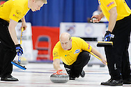 Kevin Martin, skip on Kevin Martin'steam throws his rock in the team's first draw Wednesday.  The 2011 GP Car and Home Players' Championship ran April 12-17 at the Crystal Centre, Grande Prairie, AB..11-04-13, Photo Randy Vanderveen, Grande Prairie, Alberta.