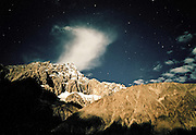 Sleeping out under the star, at the border between China and Pakistan. Pakistan..Trekking through remote Karakoram, in the Shimshal, Braldu and Shaksgam valley, finding human remains in unexplored caves hinting to the existence of an ancient trading route between Baltistan and China. Summiting unclimbed 6000m peak. Northen Pakistan, on the border with China (Xinjiang).