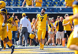 Oct 6, 2018; Morgantown, WV, USA; West Virginia Mountaineers quarterback Will Grier (7) smiles during warmups before their game against the Kansas Jayhawks at Mountaineer Field at Milan Puskar Stadium. Mandatory Credit: Ben Queen-USA TODAY Sports