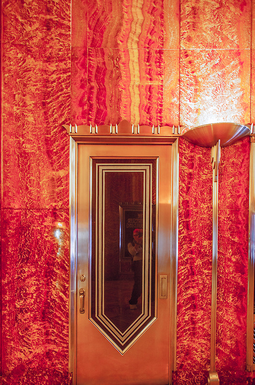 Elegant Art Deco doors, fantastic lighting fixtures. and many other exotic details are featured in the Chrysler Building's red, Moroccan marble-lined lobby