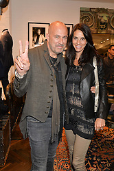 JOHN VARVATOS and his wife JOYCE at a party to celebrate the launch of the first European John Varvatos Store, 12-13 Conduit Street, London held on 3rd September 2014.