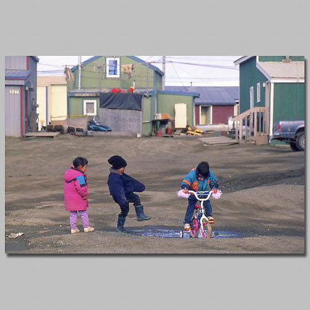 Alaska. Kids enjoy bike rides in summer.