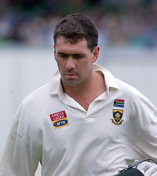 South African captain Hansie Cronje returns to the pavilion after scoring only 2 runs, during the first day of the 2nd Test between England and South Africa at the St George's ground, Port Elizabeth.  01/06/2002 : Hansie Cronje, who was on board a cargo plane that crashed in South Africa. The plane crashed near the city of George in the southern part of the country and three bodies were spotted on the ground, the South African Press Association reported.