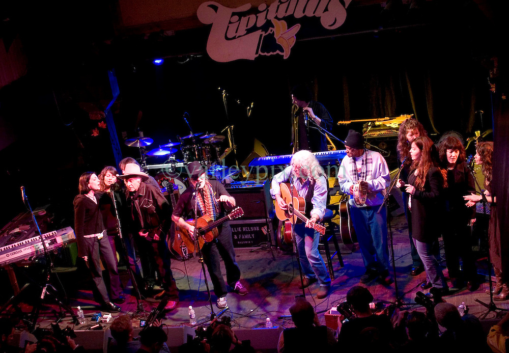 17 December, 05. Tipitina's, New Orleans, Louisiana.<br />  Arlo Guthrie and friends Riding on the city of New Orleans tour benefiting Musicares Hurricane relief 2005 sponsored by Amtrak. (mid rt white hair) Arlo Guthrie and Willie Nelson (mid left black hat) wrap up the last concert of the tour with friends on stage.<br /> Photo; ©Charlie Varley/varleypix.com