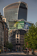 Plantation House in Green is dwarfed bt the Walkie Talkie building seen from a deserted Aldgate at rush hour during the coronavirus pandemic on the 24th April 2020 in London, United Kingdom. 20 Fenchurch  Street, also known as the Walkie-Talkie tower for its distinctive top heavy shape, is possibly one the more contentious tall buildings of recent times. It bulges out of the heart of historic London, to some literally sticking out like a sore thumb. Designed by Uruguayan architect Rafael Viñoly it has certainly left an indelible mark on London's urban fabric for better or worse.