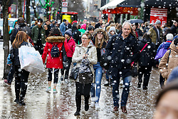© Licensed to London News Pictures. 21/12/2019. London, UK. Fake snow falls on London's Oxford Street as Christmas shoppers take advantage of pre-Christmas bargains. Retailers are expecting a rush of shoppers in the lead-up to Christmas. Photo credit: Dinendra Haria/LNP