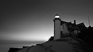 The historic Point Betsie Lighthouse on a Lake Michigan early Morning just before sunrise, Michigan's Lower Peninsula, USA