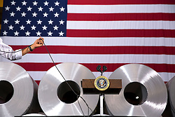 President Barack Obama participates in a town hall at Millennium Steel Service, LLC in Princeton, Ind., Oct. 3, 2014. (Official White House Photo by Pete Souza)<br /> <br /> This official White House photograph is being made available only for publication by news organizations and/or for personal use printing by the subject(s) of the photograph. The photograph may not be manipulated in any way and may not be used in commercial or political materials, advertisements, emails, products, promotions that in any way suggests approval or endorsement of the President, the First Family, or the White House.