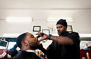 MILWAUKEE, WI - NOVEMBER 17: Cedric Fleming, right, cuts the hair of a customer at Upper Cutz barbershop on Thursday, November 17, 2016.