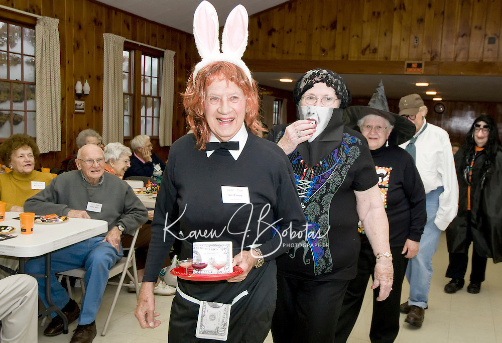 "Leading off the cast of ""characters"" is ""Bunny"" Bill Plante followed by ""frightening"" Fran Anderson, Irene Thibault and Ella Brown during Laconia Elder Friendship Club's annual Halloween Party at Leavitt Park Wednesday afternoon.  (Karen Bobotas/for the Laconia Daily Sun)"