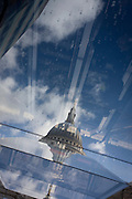 An unusual view of St Paul's Cathedral, seen reflected in a nearby shopping mall roof in the financial City of London. This image has been rotated 180 degrees vertically.