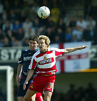 Photo: Chris Ratcliffe.<br />Southend United v Doncaster Rovers. Coca Cola League 1. 22/04/2006.<br />Kevin Maher (L) of Southend goes up for a header with James Coppinger of Doncaster