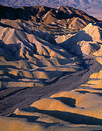 CADDV_012 - Eroded mudstone forms hills and valleys below Zabriskie Point, Panamint Range is in the distance, Death Valley National Park, California, USA