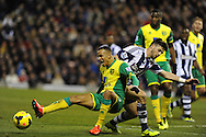 Martin Olsson of Norwich city is sent flying by Shane Long of WBA. Barclays Premier league, West Bromwich Albion v Norwich city at the Hawthorns in West Bromwich, England on Sat 7th Dec 2013. pic by Andrew Orchard, Andrew Orchard sports photography.