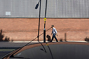 An urban landscape of a leaning lamp post and a vehicle's radio aerial, on 6th September, in London, England.