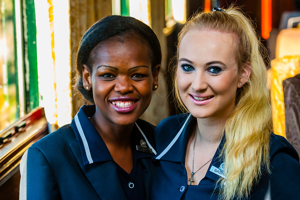 Train hostesses Zodwa Ndlovu and Sasha De Lange aboard the luxury Rovos Rail train from Pretoria to Cape Town, South Africa.