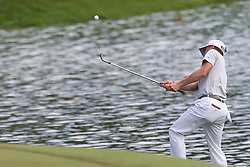 June 21, 2018 - Cromwell, Connecticut, United States - CROMWELL, CT-JUNE 21: Justin Thomas chips on to the 15th green during the first round of the Travelers Championship on June 21, 2018 at TPC River Highlands in Cromwell, Connecticut. (Credit Image: © Debby Wong via ZUMA Wire)