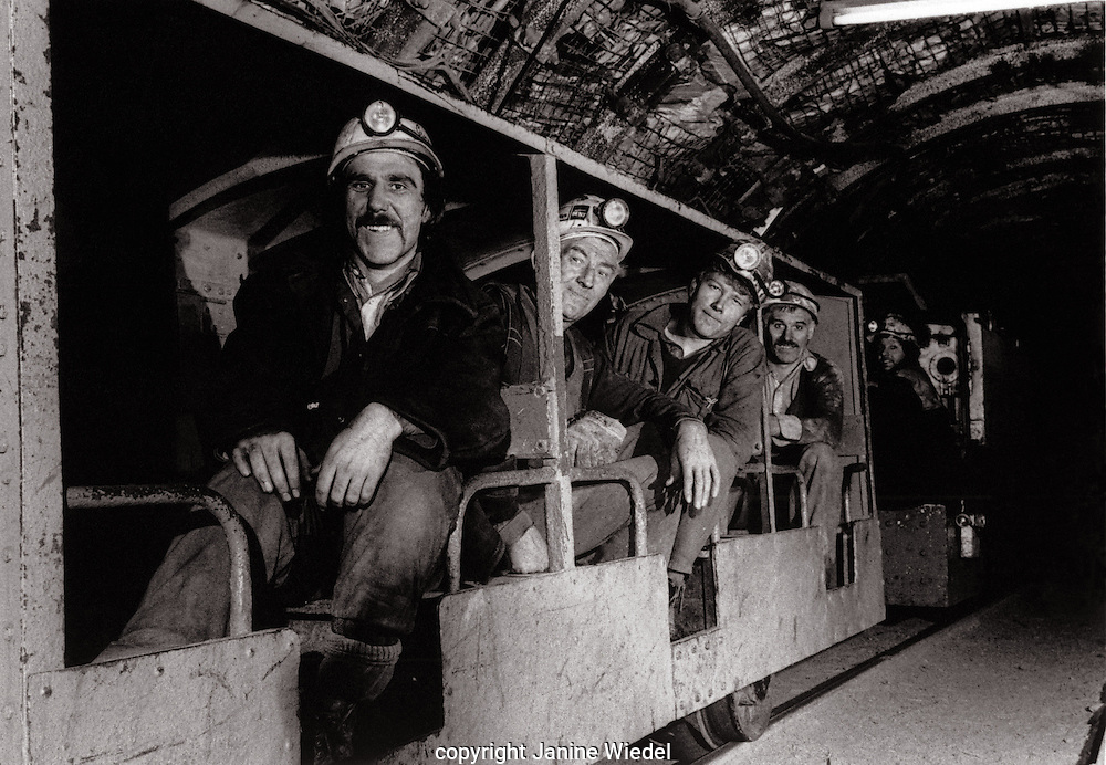 Train transporting miners  down into the mine shaft to the face Littleton Colliery Staffordshire. 1970's