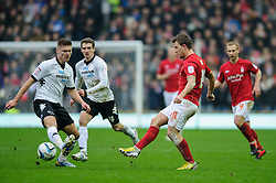 Nottingham Forest Forward Simon Cox (IRL) passes past Derby Midfielder Jeff Hendrick (IRL) during the first half of the match - Photo mandatory by-line: Rogan Thomson/JMP - Tel: Mobile: 07966 386802 19/01/2013 - SPORT - FOOTBALL - Pride Park - Derby. Derby County v Nottingham Forest - npower Championship. The meeting of these two local sides is known as the East Midlands Derby with the winner claiming the Brian Clough Trophy.