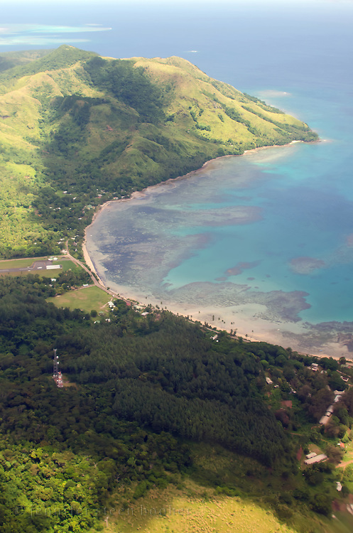 A turquoise bay lined with beaches and bright green jungle, Kadavu, Fiji Islands