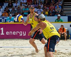 10-07-2011 VOLLEYBAL: FIVB WORLD TOUR BEACHVOLLEYBAL: GSTAAD<br /> (L-R) Jonas Reckermann, Julius Brink GER<br /> ©2011-www.FotoHoogendoorn.nl / Peter Schalk