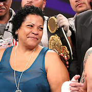 """Dominga Torres-Rivera, mother of fighter Orlando Cruz, smiles at her son during the decision after fighting Jorge Pazos at the Kissimmee Civic Center in Kissimmee, Florida, on Friday, October 19, 2012. The Puerto Rican Cruz recently described himself as """"a proud gay man"""" and the first active boxer having pronounced so, in boxing history. Cruz won the fight in a 12-round decision. (AP Photo/Alex Menendez)"""