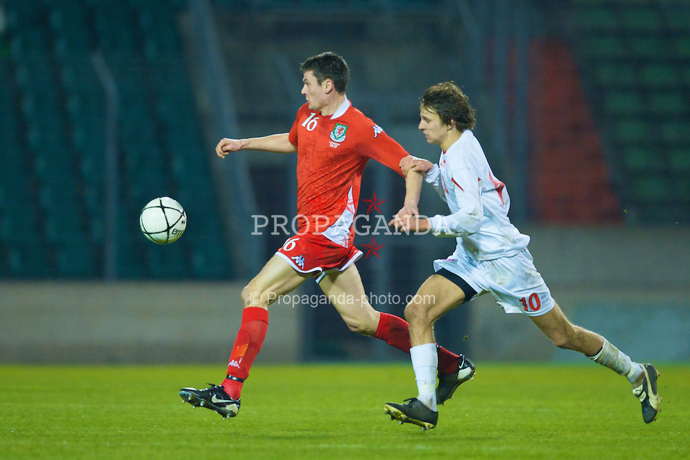 LUXEMBOURG CITY, LUXEMBOURG - Wednesday, March 26, 2008: Wales' Owain Tudur Jones and Luxembourg's Lars Gerson during the International Friendly match at the Stade Josy Barthel. (Photo by David Rawcliffe/Propaganda)