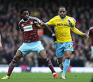 West Ham's Alex Song tussles with Crystal Palace's Jason Puncheon<br /> <br /> Barclays Premier League - West Ham United  vs Crystal Palace  - Upton Park - England - 28th February 2015 - Picture David Klein/Sportimage