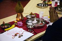 Praying during Hindu ritual chopda Poojan,