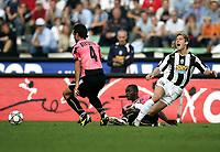 Udine, 03/10/2004<br /> <br /> Quinta giornata del Campionato di calcio Serie A<br /> <br /> Incontro Udinese-Juventus 0-1<br /> <br /> Pavel Nedved Juventus tackled by Sulley Muntari Udinese<br /> <br /> <br /> <br /> <br /> <br /> Foto Graffiti