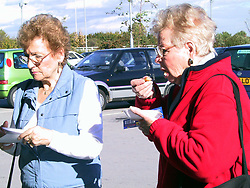While promoting the McCaine ROSTI Roadshow staff hand out samples to customers during their visit to Asda at Handsworth in Sheffield on Tuesday morning Oct 11 2001