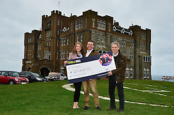 John Mappin, owner of the Camelot Castle Hotel in Tintagel, Cornwall, with his wife Irina and a cheque for £100,000 he received from William Hill's Graham Sharpe after placing a string of bets on Donald Trump becoming US president.
