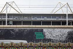 London, UK. 6th September, 2021. A mural outside ExCeL London is pictured as preparations take place inside for the DSEI 2021 arms fair. The first day of week-long protests outside the venue for one of the world's largest arms fairs was hosted by activists calling for a ban on UK arms exports to Israel.