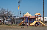 Flare in the Permain basin near a park.