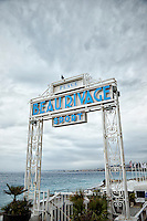 View of the Plage Beau Rivage Sport Hotel and Restaurant sign, and Bay of Angels found along the Promenade des Anglais, Nice, France.