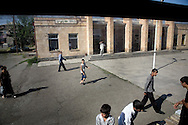 Passengers at the train station in Araks...The town was founded as a state farm in 1940. Nearby was the Battle of Sardarapat (May 1918) on whose site is erected the Sardarapat Monument.Local residents travel on train to Gyumri with the fruits they whole sale there..