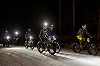 """Bikers head out towards Cobble Mountain trail at the start of the Gunstock Nordic """"Fatbike Fury"""" night race on Saturday evening.  (Karen Bobotas/for the Laconia Daily Sun)"""