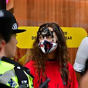 Extinction Rebellion oil protest in front of Selfridges in London, UK