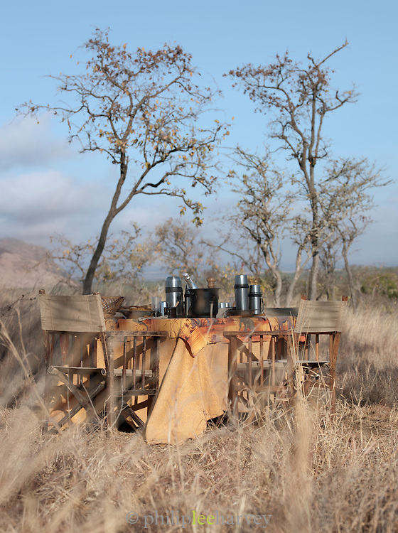 Breakfast table set up after morning safari from eco tourist camp, Chyulu Hills National Park, Kenya