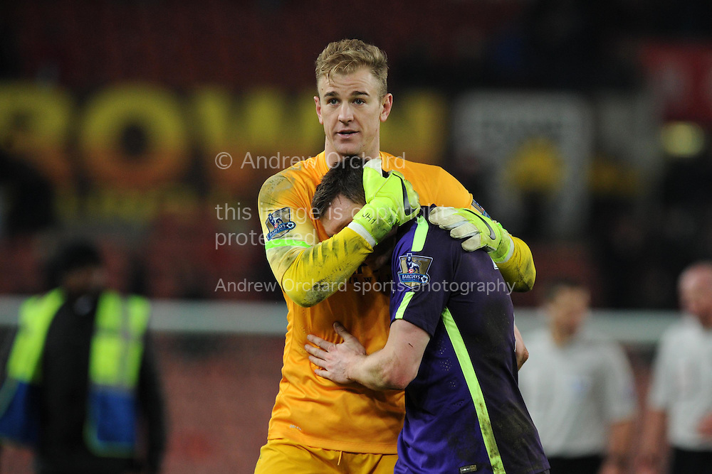 James Milner of Manchester city (r) at the end of the game as he walks off alongside goalkeeper Joe Hart. Barclays Premier League match, Stoke city v Manchester city at the Britannia Stadium in Stoke on Trent , Staffs on Wed 11th Feb 2015.<br /> pic by Andrew Orchard, Andrew Orchard sports photography.