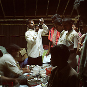 A medic in Nagappattinam, on the tsunami-hit southeastern coast of India, prepares an injection of antibiotics in an emergency shelter. .The December 26, 2004 tsunami killed thousands of people along this coast, smashing boats, roads and houses and tearing thousands of families apart. .Picture taken February 2005 in Nagapptinam, Tamil Nadu, India, by Justin Jin